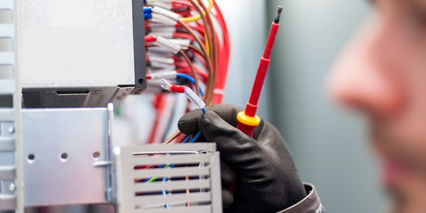 Canva---Closeup-of-electrician-engineer-works-with-electric-cable-wires