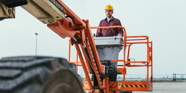 Canva---Worker-operating-Straight-Boom-Lift